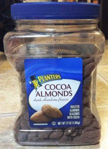 Picture of the front of a 37 ounce jar of Planters Cocoa Dark Chocolate Roasted Almonds.